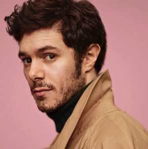 Adam Brody makes his patchy beard work for him.